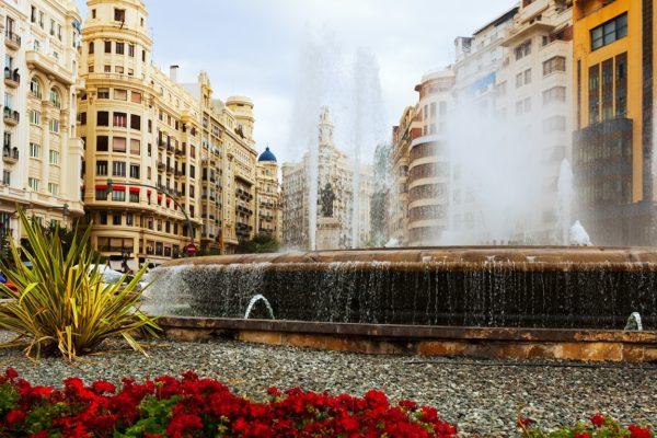 Fountain at Placa del Ajuntament in summer. Valencia, Spain